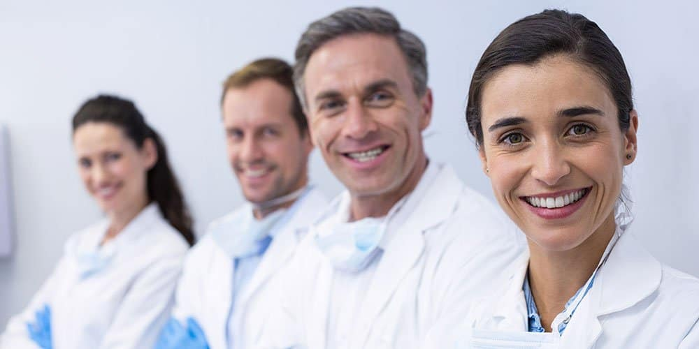 Line of smiling doctors