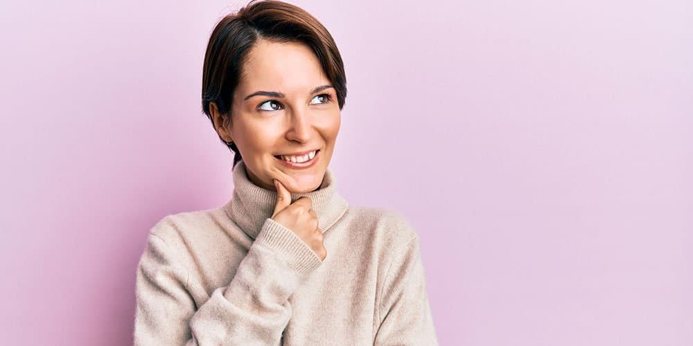 Woman smiling against purple background