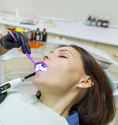 Sedated, relaxed patient receiving dental care